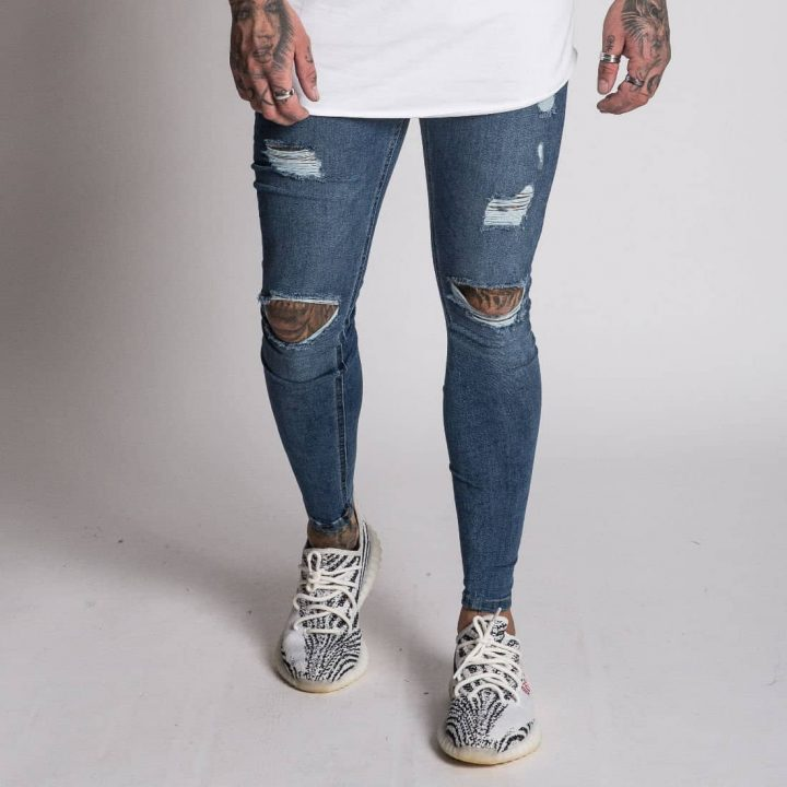 a44aefbc157 Nimes Super Skinny Spray on Jeans – Ripped & Repaired – Dark Blue